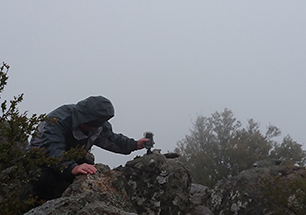 Setting timelapse cameras in storm atop Mt Kaputar
